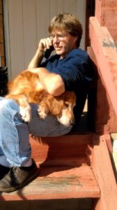 Dave on phone - Rusty on lap